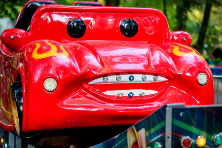 Small red car with face in amusement park