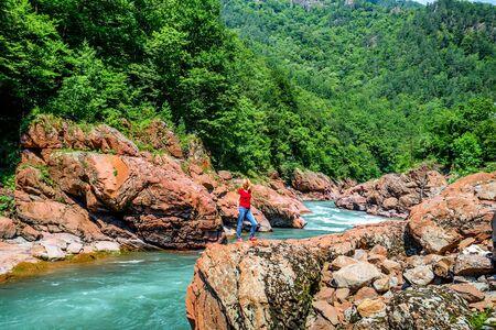 Female hiker standing on edge of rock