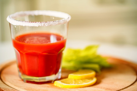 Bloody Mary alcoholic drink with lemon and celery Stock Photo