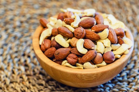 Assorted nuts in wooden bowl Stock Photo