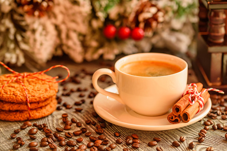 Cozy winter setting with cup of coffee