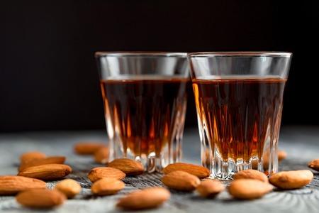 Italian amaretto liqueur with dry almonds Stock Photo