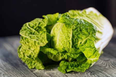 Napa or Chinese cabbage on wooden background