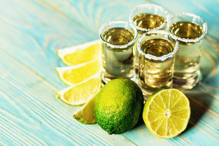 Close-up of several shots of traditional Mexican tequila with lime and salt, selective focus Stock Photo