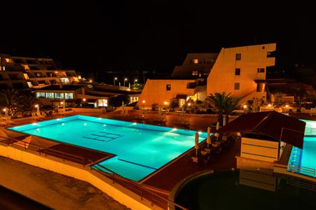 HALKIDIKI, GREECE - CIRCA JUNE 2011: Pool of Theoxenia hotel at night