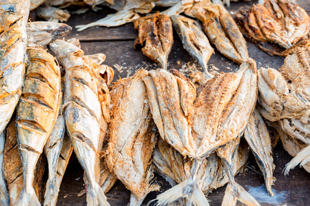 Close up sun-dried fish on wooden table