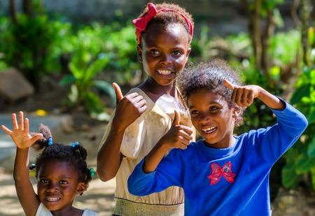 HIGUEY, DOMINICAN REPUBLIC - CIRCA NOVEMBER 2015: Three unidentified Dominican girls