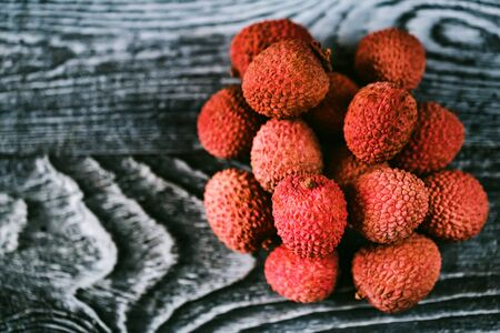 Top view lychee fruit on wooden background Stock Photo