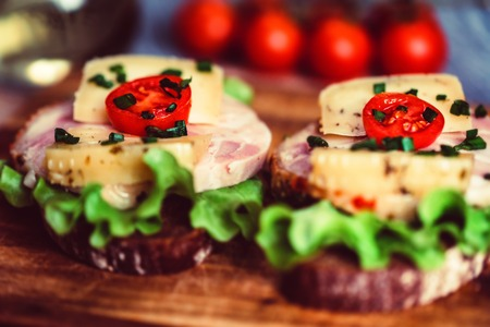 Sandwiches with cheese, turkey, lettuce and tomato Stock Photo