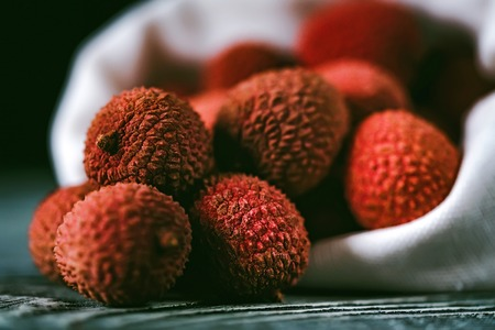 Lychee fruit in white sack close Stock Photo