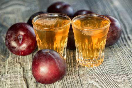Plum brandy or slivovitz with fresh and tasty plum