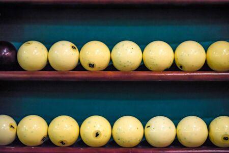 White billiard balls on shelf close Stock Photo