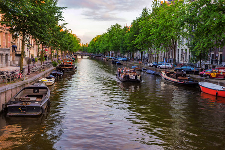 AMSTERDAM, THE NETHERLANDS - JUNE 10, 2014: Beautiful view of canal in Amsterdam Editorial