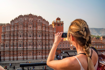 Young woman takes picture of Hawa Mahal in India Stock Photo