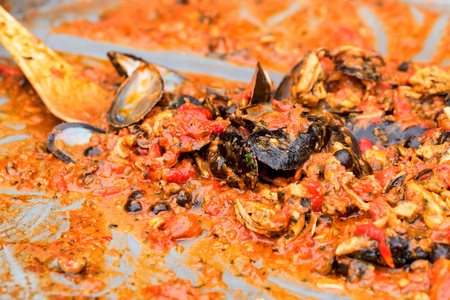 Close-up of steamed mussels with tomatoes