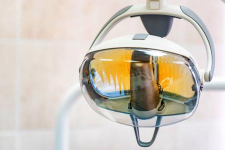 Dental light in dentist office. Dental clinic equipment - close up image of medical exam light.