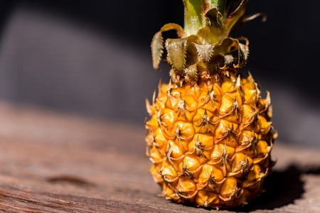 Pineapple on a dark wooden background