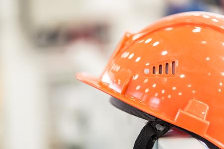 Safety helmet against industrial background
