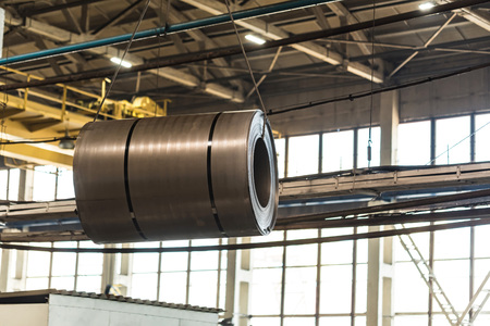 Stock with rolls of sheet steel in industrial plant 写真素材