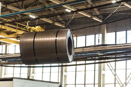 Stock with rolls of sheet steel in industrial plant Stock fotó