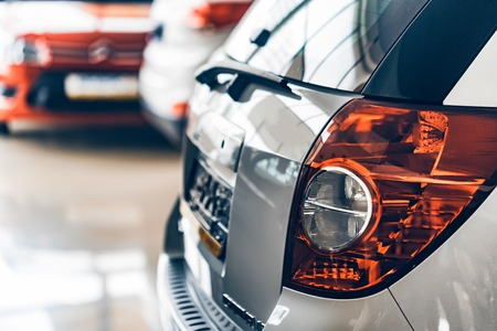 New cars at dealer showroom blurred background Stock Photo