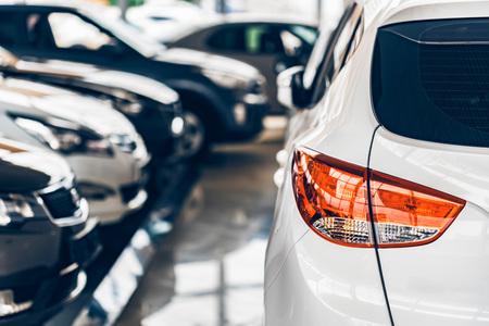 New cars at dealer showroom blurred background Foto de archivo