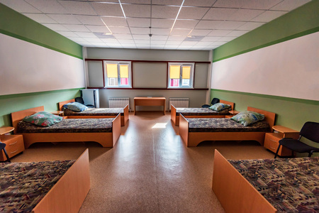 Hostel room interior with six beds