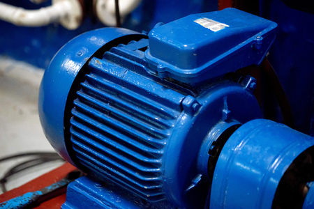 Blue electric motor close up