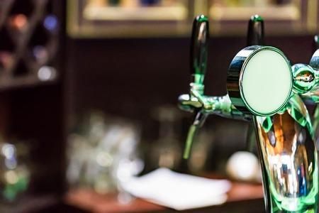 Chrome beer tap in modern bar
