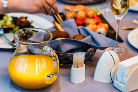 Orange juice in jug on restaurant table