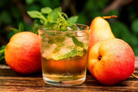 Ripe pears and pear drink on a wooden table Stock fotó