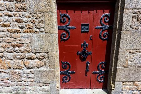 Door of medieval abbey Mont Saint-Michel, France