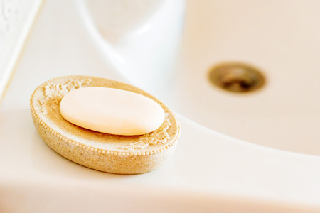 Soap on a dish over ceramic sink 写真素材