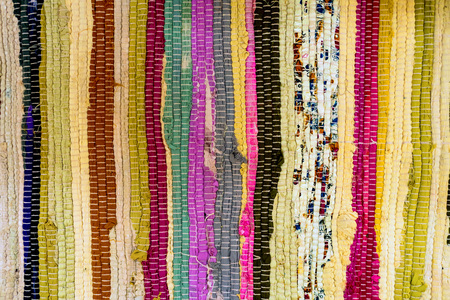 Old colorful woven doormat texture close up Banco de Imagens