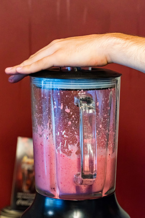 Cooking berry smoothie in blender close up 写真素材
