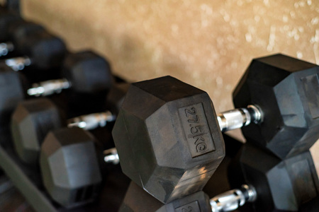 Close up image of chrome dumbbells in gym