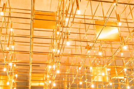 Modern metal lighting construction on the ceiling that looks like bamboo Stock Photo - 110845598