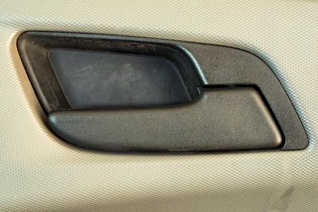 Modern plastic car door handle from inside close