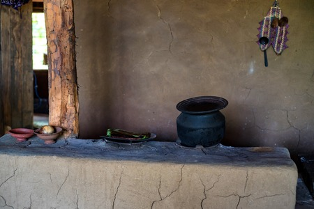 Traditional rural cooker in Sri Lanka with pots on top of it Banco de Imagens - 114351126