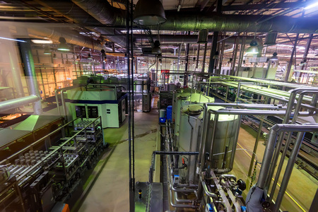 Industrial interior of soft drinks factory with tubes