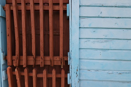 Close up old weathered wooden shutters outside
