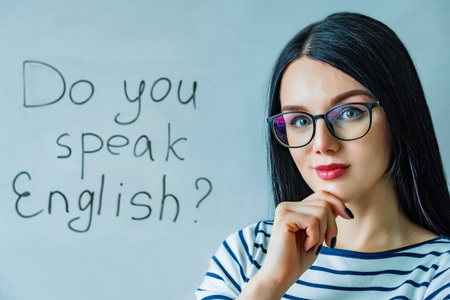 Beautiful girl with glasses and words do you speak English Archivio Fotografico