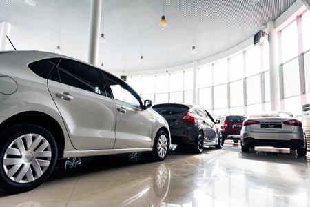 New cars at dealer showroom close view