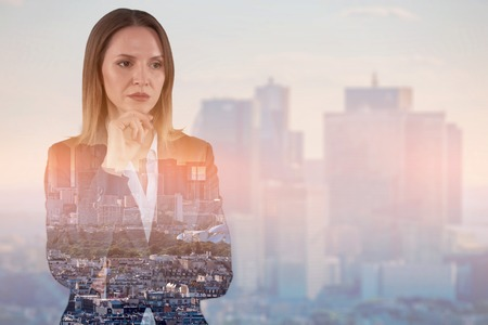 Double exposure image of businesswoman on cityscape