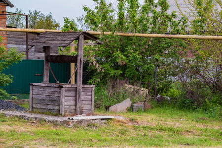 Old wooden well in back yard in the countryside Stok Fotoğraf