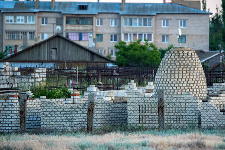 View of beautiful small Muslim graveyard outdoors with stone tombs