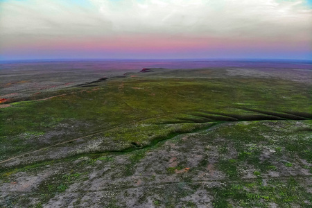Beautiful landscape with sunset over steppe near lake Baskunchak