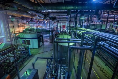 Industrial interior of soft drinks factory with tubes and reservoires Stock Photo