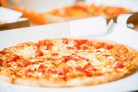 Delicious fresh pizza Margherita with tomatoes and cheese close up in paper box Reklamní fotografie - 124863927