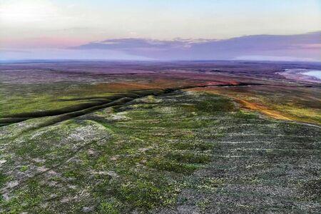 Beautiful landscape with sunset over steppe near lake Baskunchak